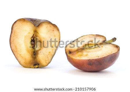 Old apple cut in two half on white background - stock photo