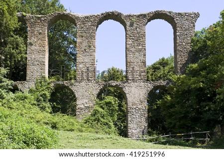 Old aqueduct - stock photo