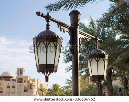 Old arabic metal streetlight in Dubai - stock photo