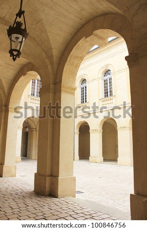 old arcades of Uzes city hall, France - stock photo