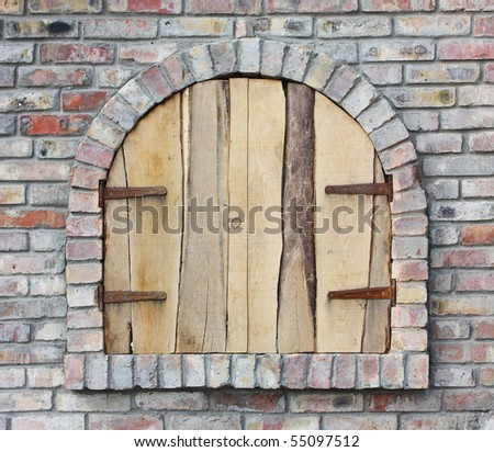 old arched window, closed with boards - stock photo