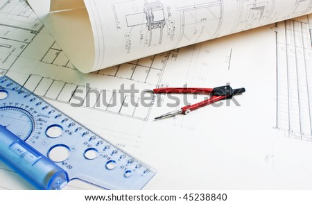 Old architectural drawing with a ruler and compass - stock photo