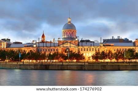 Old architecture at dusk on street in Old Montreal in Canada panorama - stock photo