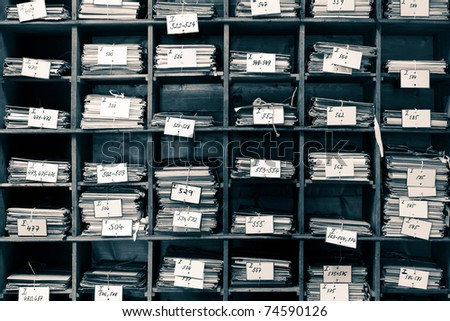 Old archive with publication and documents - stock photo