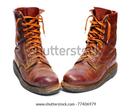 Old army paratroopers combat boots on white background. - stock photo