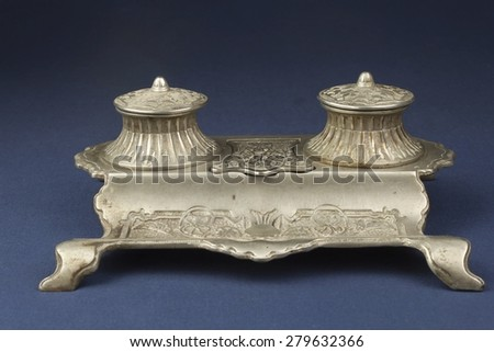 old Art Nouveau inkwell on his desk, metal alloy - stock photo