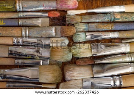 Old artist brushes on the table - stock photo