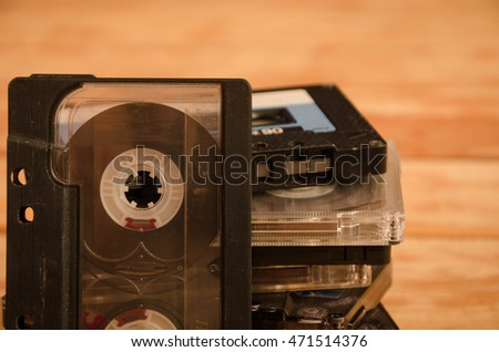 Old audio cassettes on wooden background. music abstract