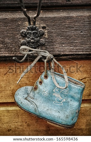 old baby shoes as wall decoration - stock photo