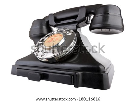 Old bakelite telephone. Shot from low wide angle. Isolated on white with clipping path - stock photo
