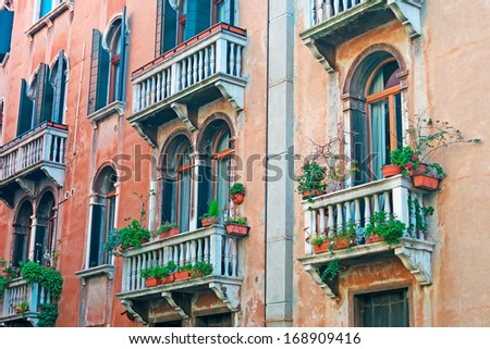 old balconies in a Venice colorful building - stock photo