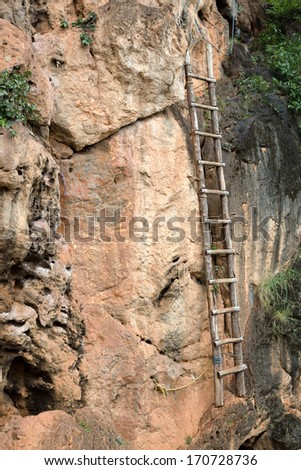 Old bamboo ladder - stock photo