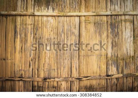 old bamboo wood sheet wall - stock photo