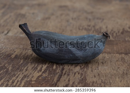 Old banana on a wooden table