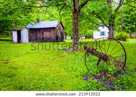 Old barn and farm equipment at  Millbrook Village, at Delaware Water Gap National Recreational Area, New Jersey. - stock photo