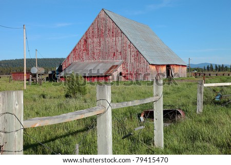 Old barn and fence, Oregon. - stock photo
