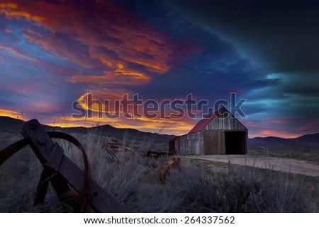 Old Barn at Sunrise - stock photo