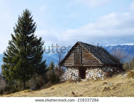 Old barn in the top of the mountain - stock photo