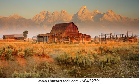 Old barn sits in front of the Grand Teton Mountains, Wyoming.
