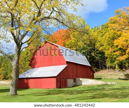 Old barn with fall colors in the rural Michigan countryside