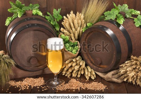 old barrel with hops, wheat, grain, barley and malt - stock photo