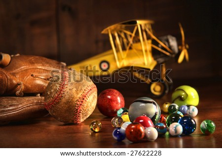Old baseball and glove with antique toys on wood floor - stock photo