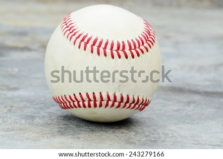 Old baseball on a gray concrete background - stock photo