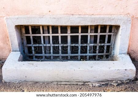 Old basement window with bars - stock photo