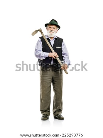 Old bearded bavarian man in hat holding hoe in his hand, isolated on white background - stock photo