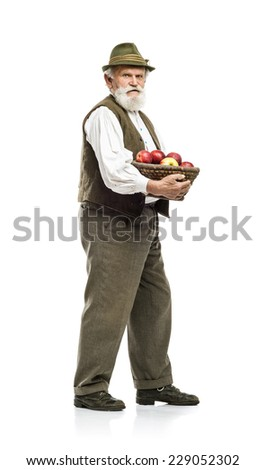 Old bearded farmer man in hat holding basket full of apples, isolated on white background - stock photo
