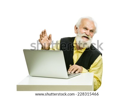 Old bearded man with laptop isolated on white background - stock photo
