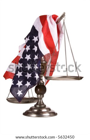 Old, beat up scale with an American flag draped over it.  Isolated on white.  Some scratches and pitting can be seen on the scale. - stock photo