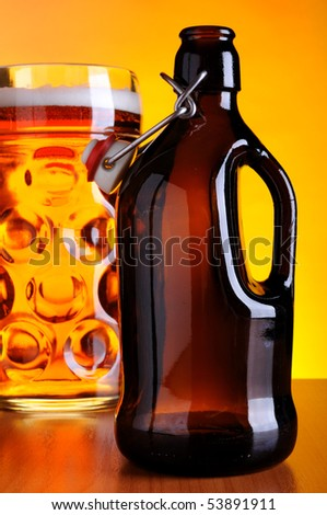 Old beer bottle and mug - stock photo
