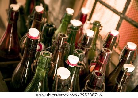 Old beer bottles in wooden cases - stock photo