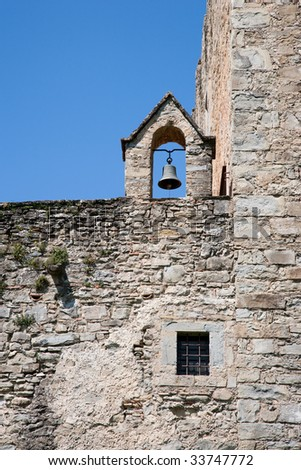 Old bell on abbey wall
