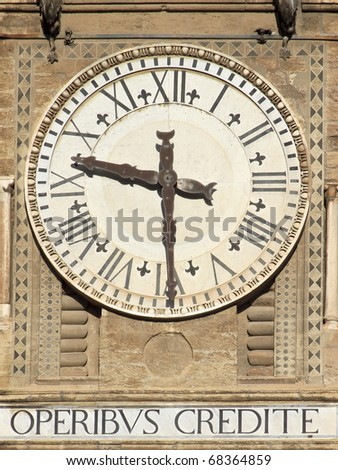 Old bell tower clock with Latin motto on Palermo Cathedral, Italy - stock photo