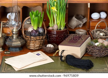 old bible book with easter eggs and vintage things - stock photo