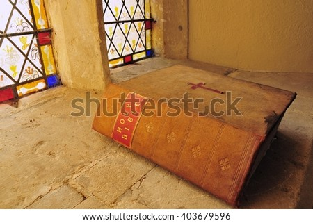 Old Bible in a Church  - stock photo