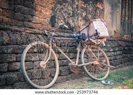 Old bicycle in invoice wall artwork - stock photo