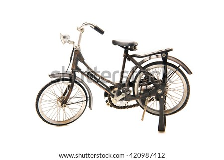 Old bicycle model isolated on a white background. - stock photo