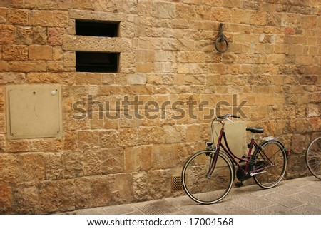 Old bicycle on italian street (Florence) - stock photo