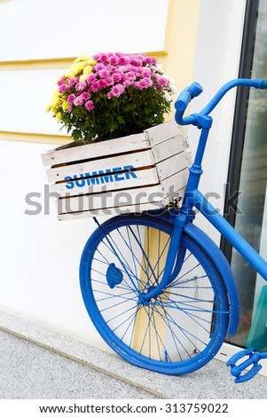 old bicycle with flowers box - stock photo