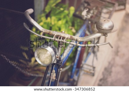 Old bicycle with light in retro style - stock photo
