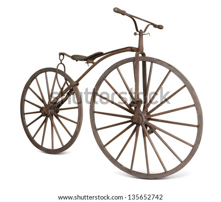 old bicycle with wooden wheels isolate  with clipping path - stock photo