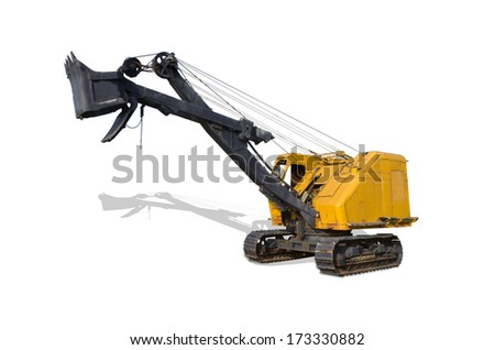 Old big dredge digs a iron ore isolated on white, with clipping paths. - stock photo