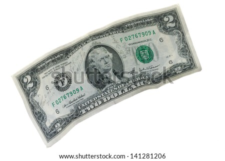 Old $2 bill with handwriting on a white background