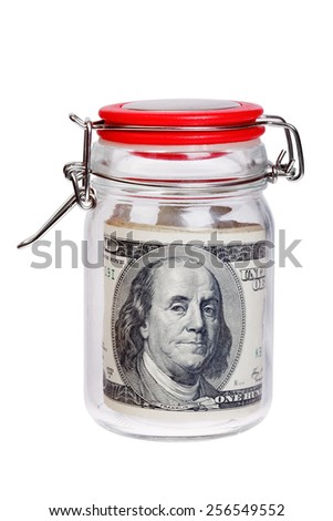 Old bills of 100 US dollars in a glass jar isolated on white background. - stock photo