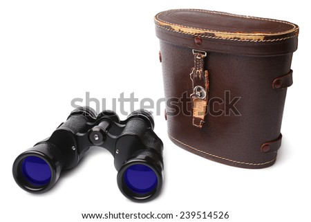 Old binoculars and leather case on white background - stock photo