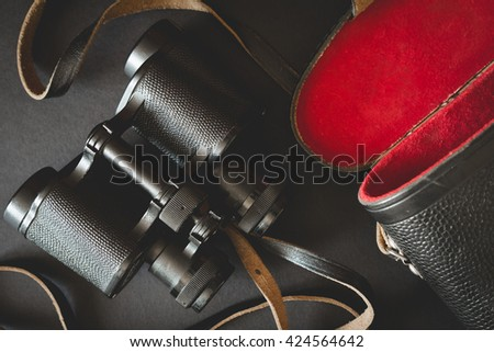 Old binoculars on black background