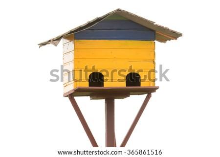 Old bird house nest isolated on white. - stock photo